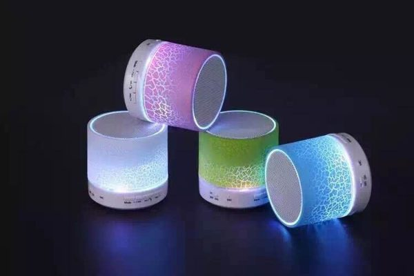 Corporate Merchandise: Logo printing on promotional gifts and wireless bluetooth speakers